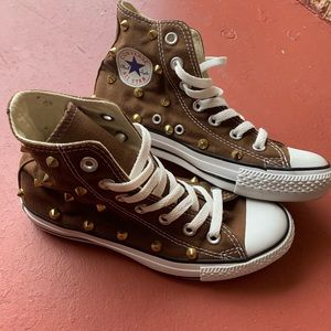 Brown studded converse